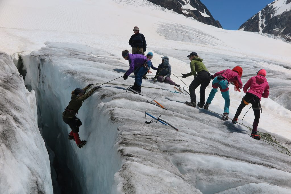 Abseiling into a crevasse on Langglacier